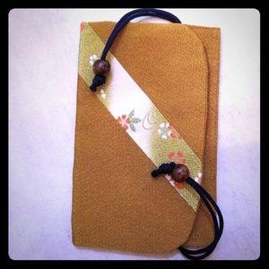 Handbags - NWOT Silky golden pouch/clutch